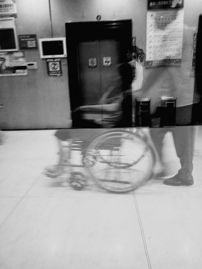 Blurred Motion Motion Speed Bicycle Indoors  Built Structure Sport Transportation Architecture Day Wheelchair People Laundromat City Cleaning Equipment Riot Hospital