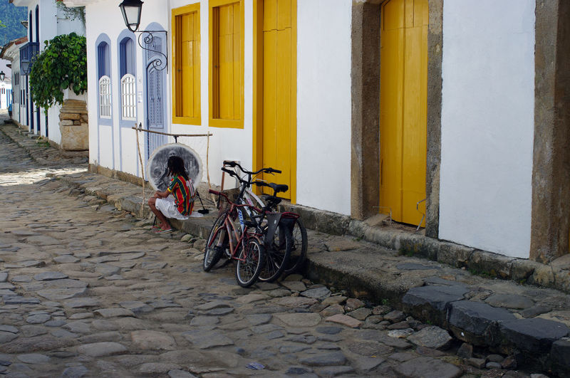 Architecture Bicycle Building Building Exterior Built Structure City Cobblestone Colonial Architecture Colorful Day Direction Footpath Land Vehicle Mode Of Transportation No People Outdoors Parking Pavement Residential District Stationary Street Transportation Yellow