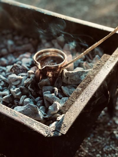 High angle view of utensil on coal