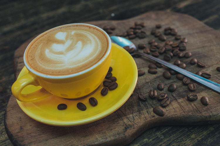 Coffee Cup of Latte art with coffee beans on wooden background Beans Beverage Capuccino Addict Cafe Cappuccino Close-up Coffee - Drink Coffee Cup Cup Day Drink Enjoying Life Food And Drink Freshness Froth Art Frothy Drink Indoors  Marijuana No People Refreshment Saucer Serving Size Table Water