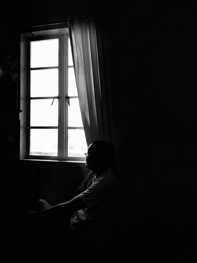 Morning View Streetphotography Blackandwhite Window Indoors  One Person Home Interior Curtain Domestic Room Day Sitting Looking Through Window Depression - Sadness Contemplation Dark Real People Adult Sadness