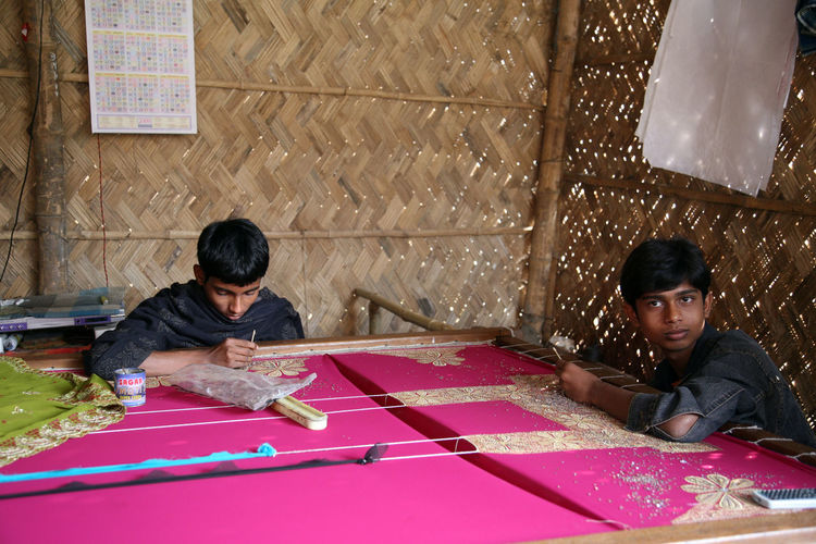 Child workers working on the decoration of textiles in Kumrokhali, India on Jan 16, 2009. Child Children Employment India Job Kid Kumrokhali Laborer Poor  Poverty Teenager Textile Underpaid West Bengal Worker
