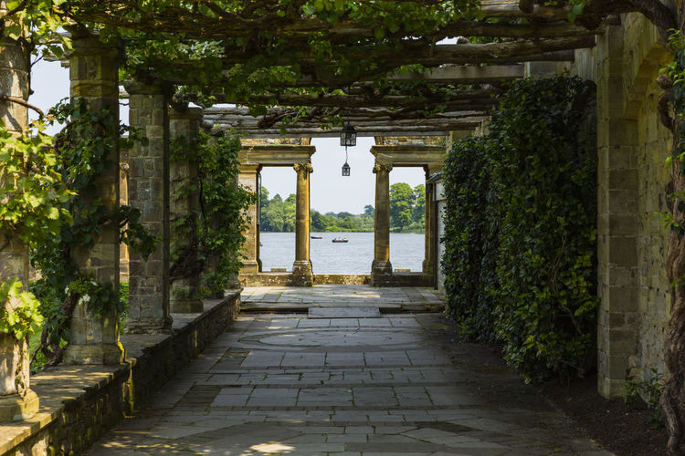 A trellis walkway leading to Hever Lake, Hever Castle & Gardens, Hever, Edenbridge, Kent, England, United Kingdom Architecture Built Structure Day Growth History Nature No People Outdoors Plant Scenics The Way Forward Tree Water