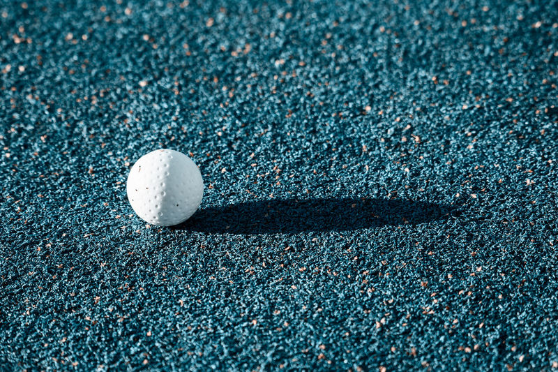 field hockey ball Field Hockey Ball Baseball - Sport Close-up Day Golf Golf Ball High Angle View Land Leisure Activity Nature No People Outdoors Sand Selective Focus Single Object Sport Sports Equipment Still Life Sunlight White Color