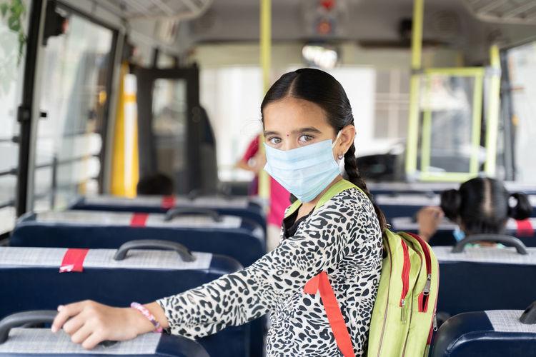 Portrait of girl in bus