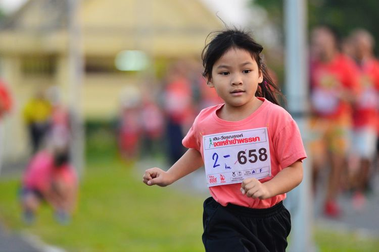A new runner Buriram Surin race Thailand A New Beginning Casual Clothing Child Childhood Day Focus On Foreground Front View Girls Hairstyle Incidental People Innocence Lifestyles Looking At Camera Marathoner New Marathoner New Runner One Person Outdoors Portrait Real People Smiling Standing Three Quarter Length Women