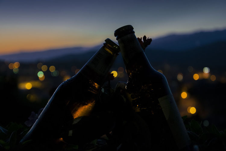 Close-up of alcohol bottles at night