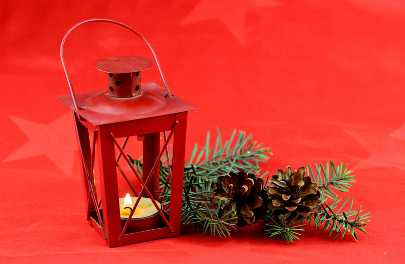 Close-up of christmas decoration on table against wall