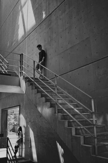 Up and Down Staircase Architecture Steps And Staircases Real People Built Structure Railing Walking People Men High Angle View Building Exterior Moving Up Lifestyles Day Building Transportation Wall - Building Feature Outdoors Blackandwhite Couple #NotYourCliche Love Letter