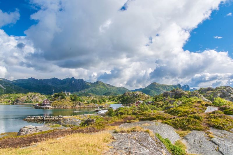 Mountain Sky Beauty In Nature Scenics Nature Water Cloud - Sky Mountain Range Tree Outdoors Day Lake Lofoten Landscape Seashore Kabelvåg Tranquil Scene Tranquility No People Growth Grass Architecture