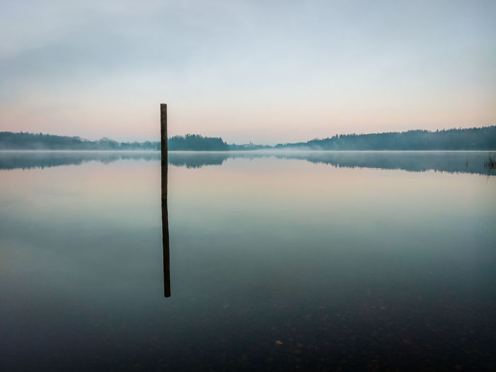 moody morning Nature Sunshine Colorful Moody Sky Moody Landscape_photography Nature Photography Naturelovers Sea Alps Water Lake Blue Sunset Fog Dawn Reflection Sky Horizon Over Water Landscape Wooden Post Symmetry Reflecting Pool Idyllic Atmospheric Mood Standing Water Foggy Reflection Lake Lakeshore Non-urban Scene Sky Only