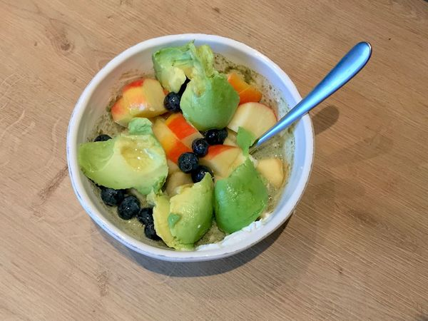 Healthy breakfast with avocado and fruits and oats Nobody Real Food Healthy Diet Avocado Keto Food Food And Drink Food Healthy Eating Freshness Wellbeing Fruit Bowl Breakfast Spoon High Angle View No People Ready-to-eat Directly Above Indoors  Table