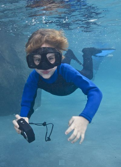Animal Wildlife Aquatic Sport Blue Child Diving Equipment Eyewear Full Length Leisure Activity Looking At Camera One Person Photography Portrait Real People Scuba Diving Scuba Mask Sea Snorkeling Swimming Swimming Goggles Swimming Pool UnderSea Underwater Underwater Diving Water