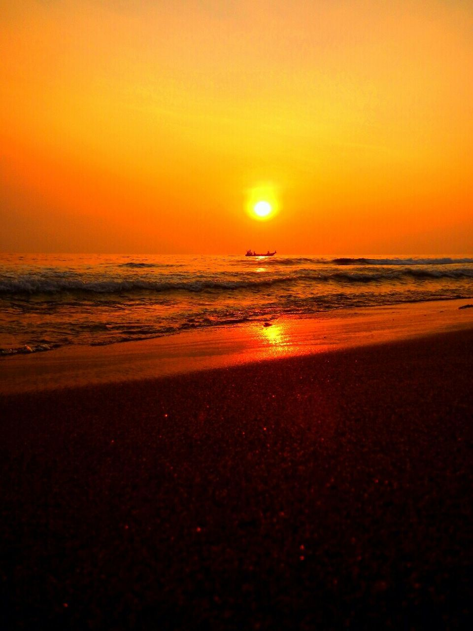 sunset, sea, beach, beauty in nature, sun, scenics, nature, orange color, tranquil scene, tranquility, horizon over water, water, idyllic, outdoors, sky, sunlight, sand, no people, vacations, clear sky, wave