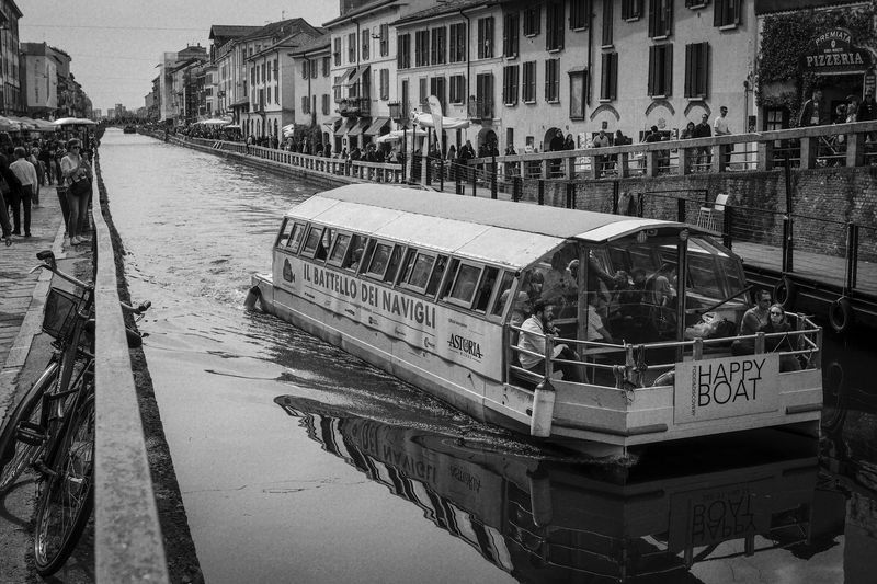 Alzaia Naviglio Grande Architecture Building Exterior Built Structure City Day High Angle View Incidental People Mode Of Transportation Motor Vehicle Nature Nautical Vessel Outdoors Reflection River Street Transportation Water Summer In The City