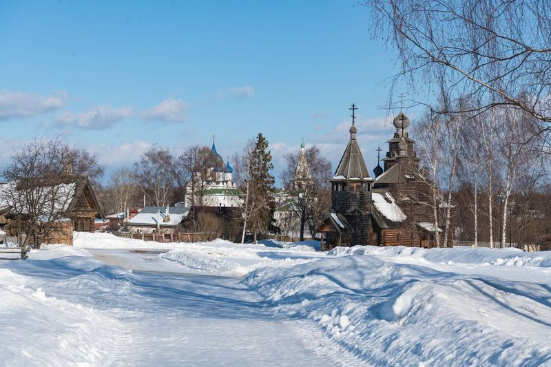 The museum of wooden architecture in Suzdal Wooden Architecture Wooden Museum Snow Cold Temperature Winter Sky Nature Tree Plant White Color Day No People Scenics - Nature Covering Field Landscape Land Beauty In Nature Outdoors Frozen Snowcapped Mountain