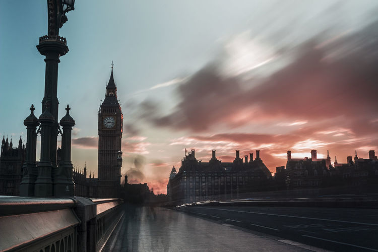 Blurred Motion Of People On Westminster Bridge By Big Ben Against Sky During Sunset