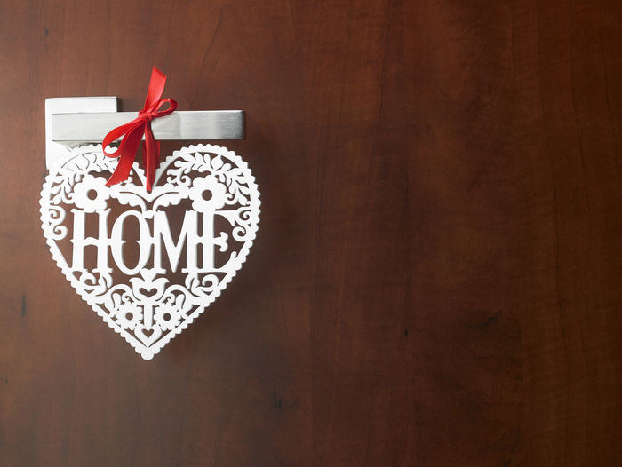 Heart shape tag with home text on door handle