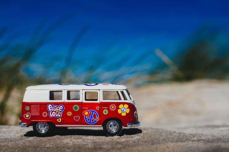 Toy van on rock at beach