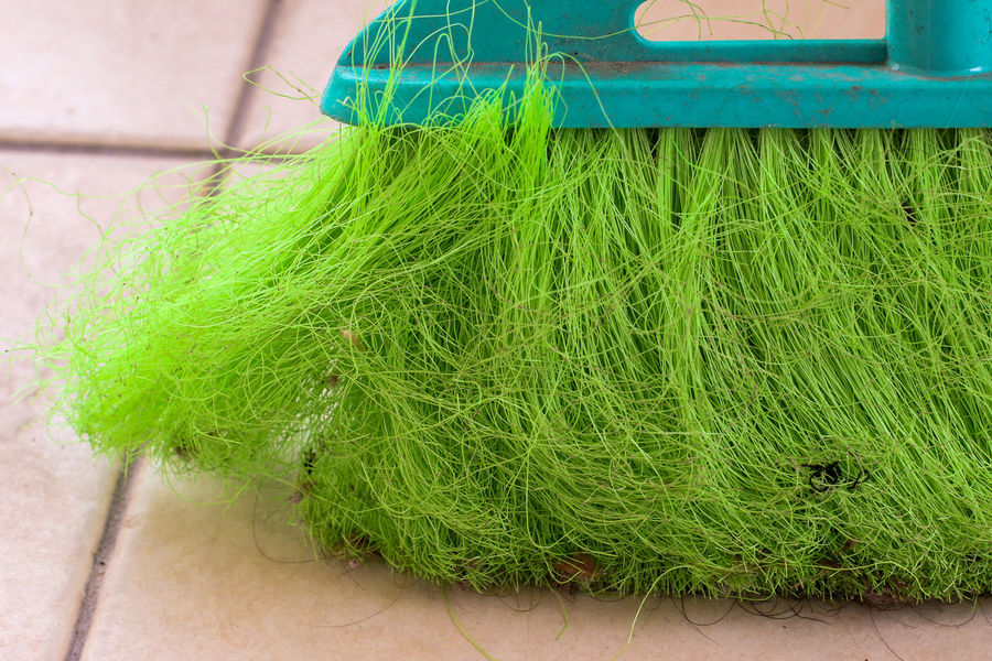 Close up of used sweep kitchen green broom. Cleaning Everyday Lives Trash Broom Broomstick Clean Cleaning Tools Close-up Colour Of Life Day Freshness Green Color Growth High Angle View Indoors  Kitchen Nature No People Object Recycling Sweep Tiled Floor Tools Used Vibrant Color