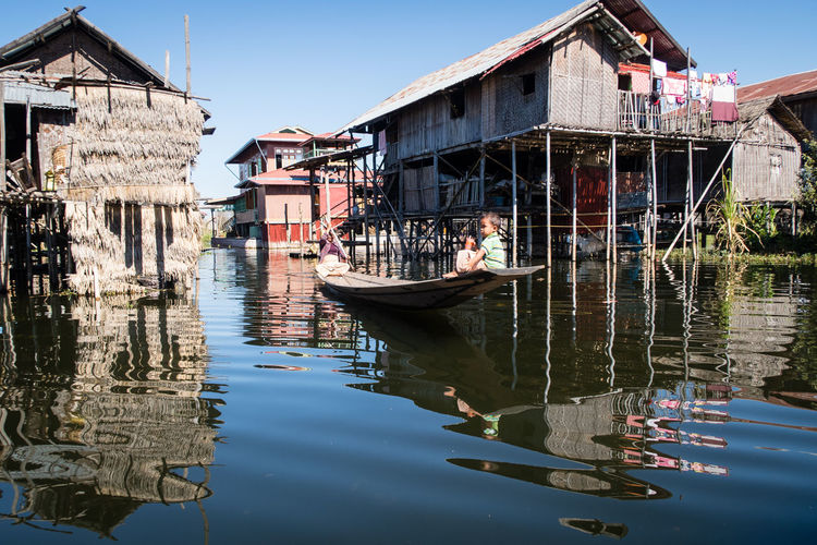 Architecture Boat Building Exterior Burma Canal Miles Away Cultures Day Floating On Water Floating Village Gondola - Traditional Boat Inle Lake Lake Long Boat Myanmar Nautical Vessel Outdoors People Reflection Tourism Tranquil Scene Transportation Travel Travel Destinations Water