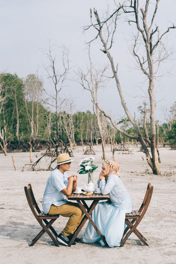 Couple At Date Against Bare Trees