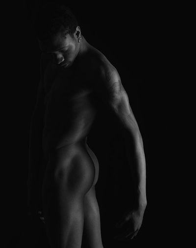 Naked Man Against Black Background
