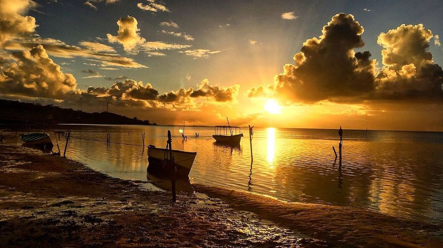 Sunset Water Beauty In Nature Nature Sea Scenics Sky Tranquility Reflection Sunlight Idyllic Tranquil Scene Nautical Vessel Outdoors Sun No People Cloud - Sky Sunbeam Beach Moored Pirogue Rodrigues Island