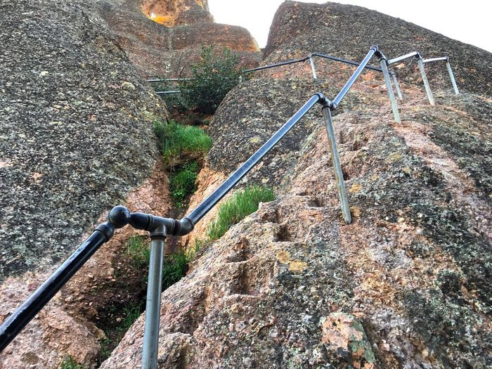 Climbing A Mountain Pinnacles Pinnacles National Park Beauty In Nature Climbing Day Formation Low-angle Shot Low-angle View Metal Mountain Nature No People Outdoors Pinnacle Rock Rock - Object Rock Formation Scenics - Nature Solid Staircase Wall - Building Feature