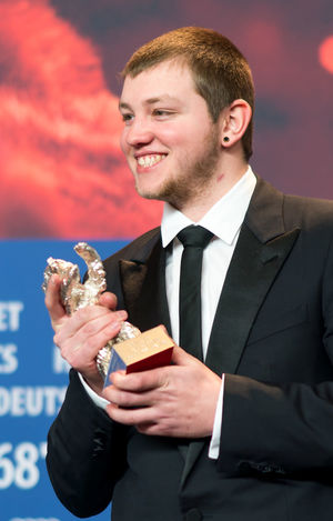 Berlin, Germany - February 24, 2018: Anthony Bajon, winner of the Silver Bear for Best Actor for 'The Prayer', poses with his award after the closing ceremony during the 68th Berlinale Festival 2018 AWARD Best Actor Closing Ceremony Film Festival Anthony Bajon Arts Culture And Entertainment Berlinale Berlinale 2018 Berlinale Festival Berlinale2018 Close-up Entertainment Entertainment Event Mass Media Men One Person People Prize Silver Bear Smiling Suit The Prayer Well-dressed Winner Young Adult
