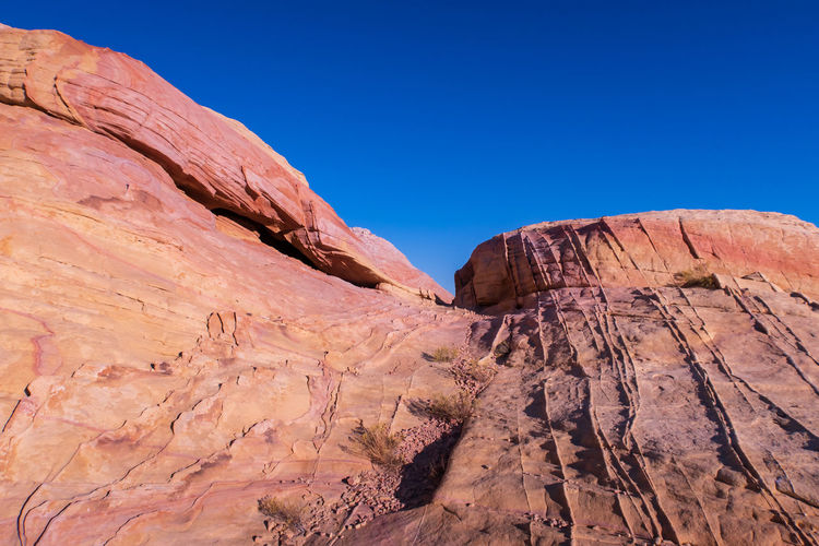 Low angle landscape of pink and purple jagged rock at valley of fire state park in nevada