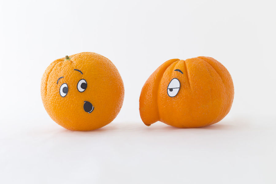 Fresh oranges with funny faces in front of white background. One orange has a huge nose Funny Orange Tropical Fruits Annoyed Astonishment Cartoon Citrus Fruit Close-up Discrimination Expression Faces Food Food And Drink Fruit Healthy Eating Huge Juicy No People Nose Orange Color Still Life Style Surprise Vitamin C White Background