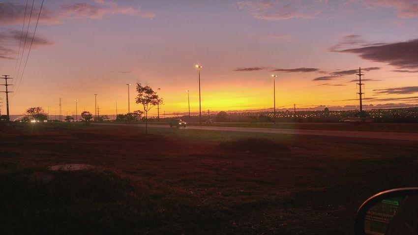 nascer do Sol Samambaia DF PorDoSol😍 Lgg5photography Pordosol Samambaia Brasília Sunlight Tree Technology Sunset Sport Playing Field Sky Cloud - Sky Grass