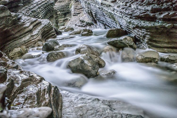 Long exposure of stream amidst rocks