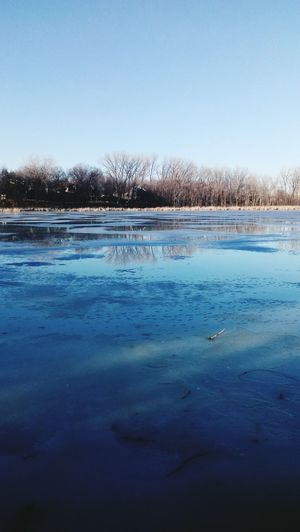 Reflection Water Frozen Nature Lake Winter Snow Ice Outdoors Sky No People Beauty In Nature Day Seasons Cold Temperature