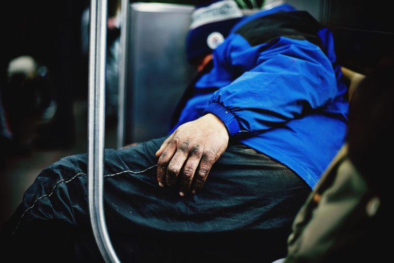 Side view of man sleeping in train