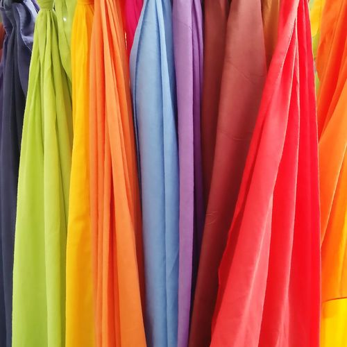 Close-up of multi colored clothes hanging in store