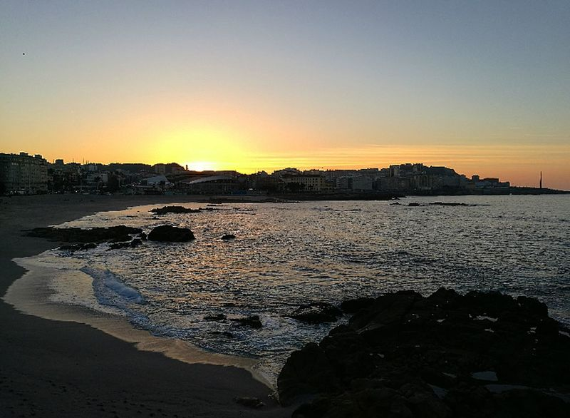 Sunset Water Reflection Silhouette Outdoors Nature Beauty In Nature Sky Scenics Tree Beach Social Issues Sea Landscape No People Day Acoruña Riazor Galicia, Spain Tranquility