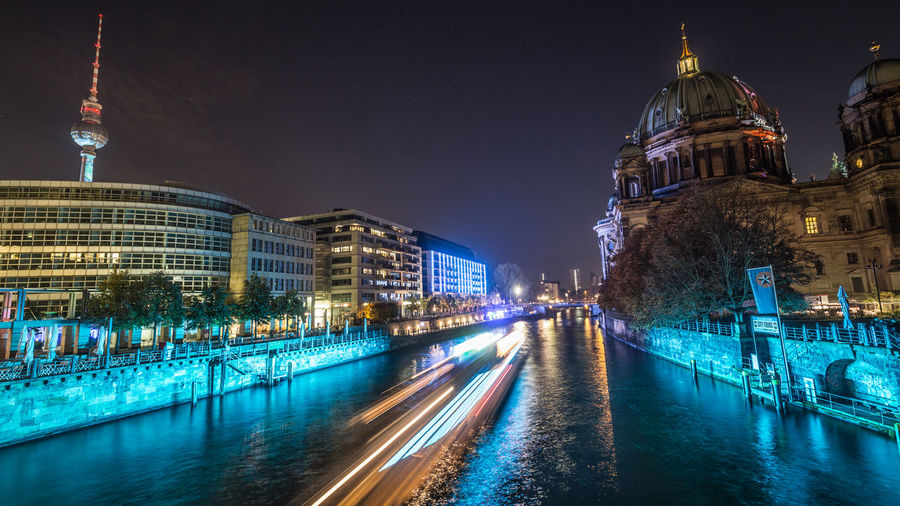 Light painting in canal against buildings at night