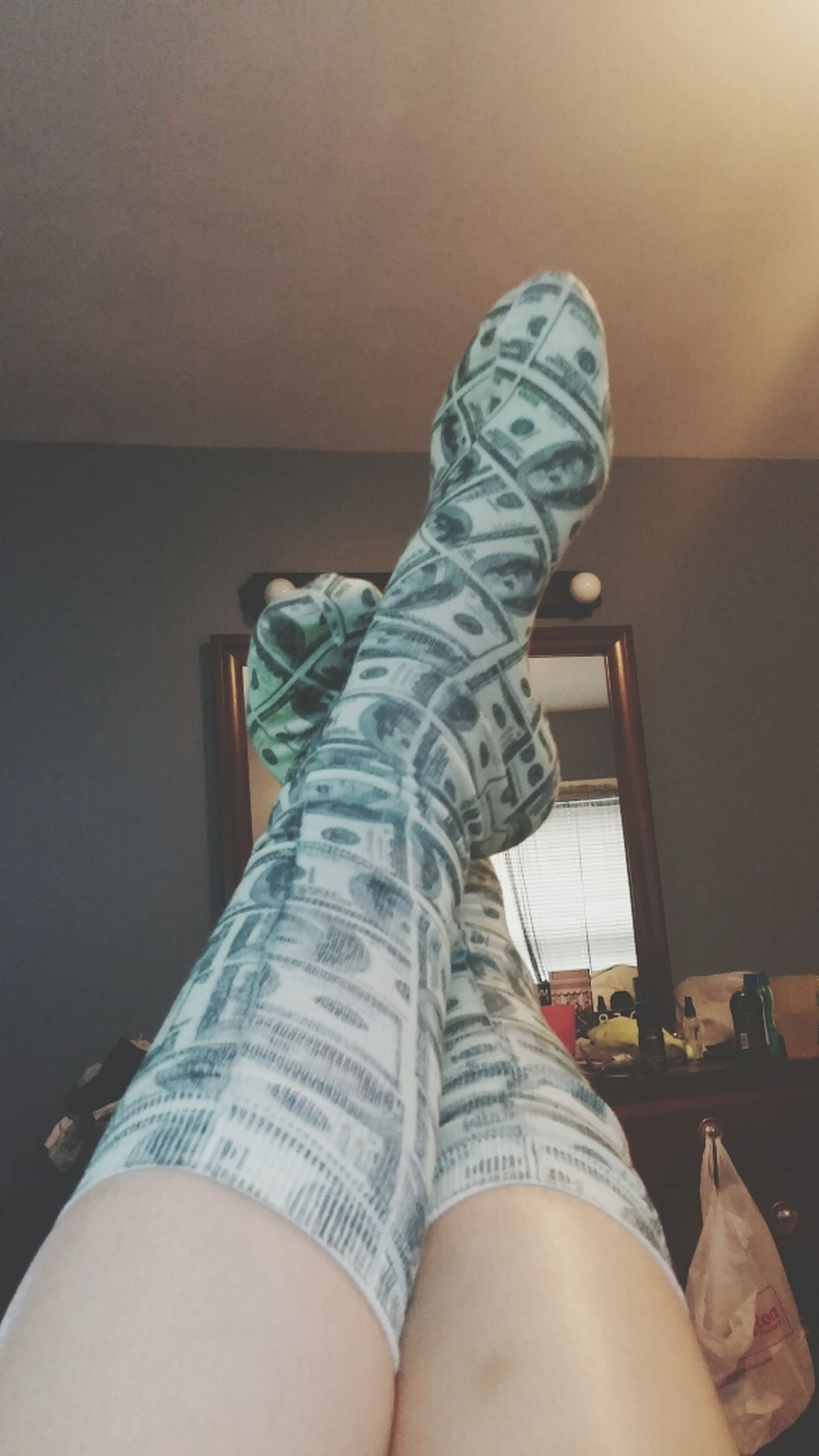 indoors, low section, person, personal perspective, lifestyles, home interior, relaxation, shoe, human foot, casual clothing, jeans, sitting, leisure activity, standing, bed, legs crossed at ankle