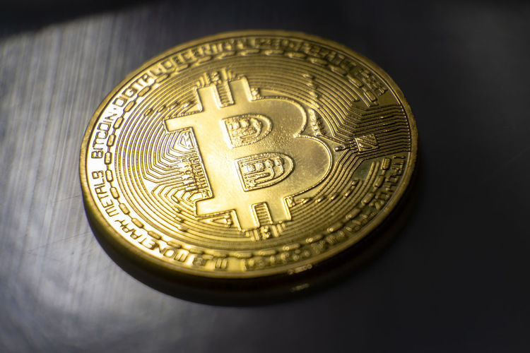 Bitcoin, virtual world payment system Business Economy Gold Golden Money Money Money Virtual Bitcoin Black Background Business Circle Close-up Coin Currency Dollar Sign Dollars Economy Euro Finance Geometric Shape Gold Gold Colored Indoors  Investment Metal Money No People Representation Shape Single Object Still Life Studio Shot Text Wealth Western Script