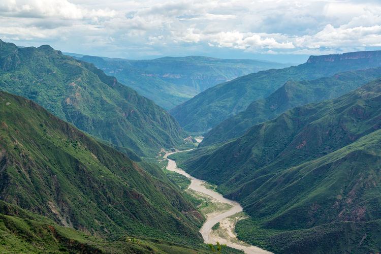 Scenic view of mountains against cloudy sky at chicamocha canyon
