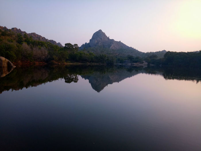 Reflection Lake Water Symmetry Sky Nature Sunset Mountain Tranquil Scene Scenics Tranquility Beauty In Nature Outdoors No People Tree Landscape Dawn Day AI Now EyeEmNewHere EyeEm Ready
