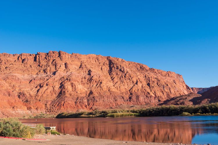 Landscape of the colorado river and large red stone hillside at lees ferry in marble canyon arizona