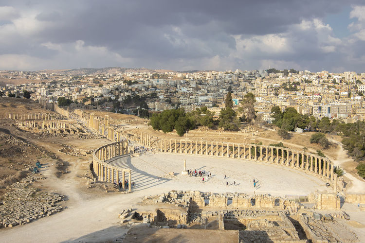 High angle view of  the roman city of jerash, jordan, against cloudy sky