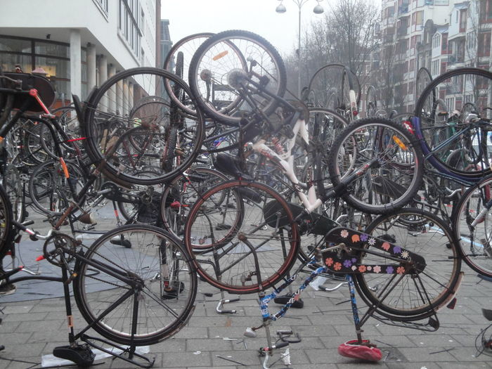 Architecture Bicycle Bicycle Art Bicycle Rack Building Exterior Built Structure City Day Land Vehicle Mode Of Transport No People Outdoors Parking Spoke Stationary Transportation