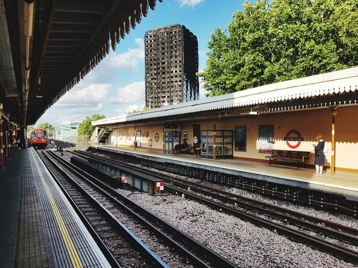Railroad Track Railroad Station Train - Vehicle Public Transportation Built Structure Architecture Day Sky City Building Exterior Outdoors London Latimer Road Grenfell Tower Fire Burn Match Disaster Fire Uk England Rail Transportation People EyeEm LOST IN London