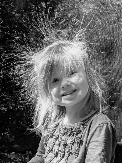 Portrait of smiling girl with tousled hair