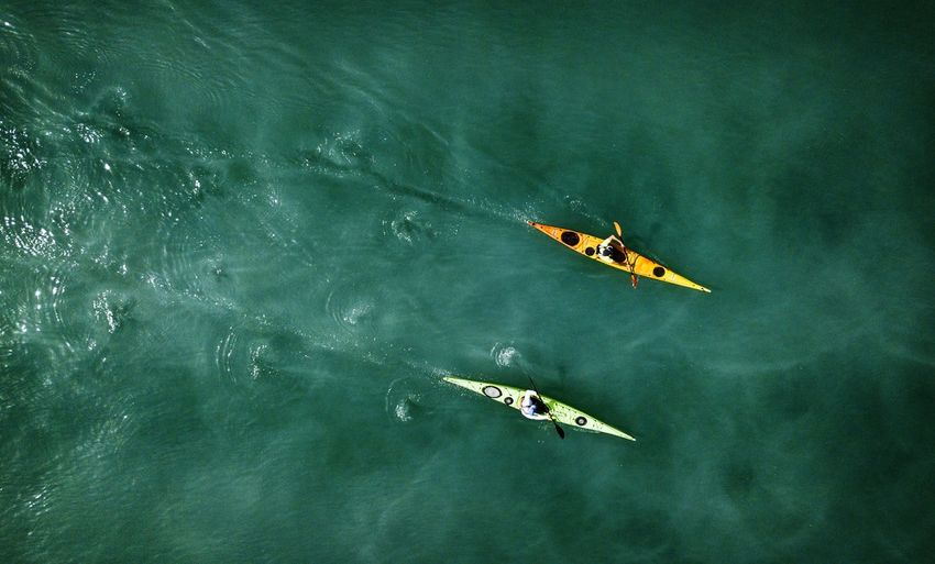 People Kayaking In Sea