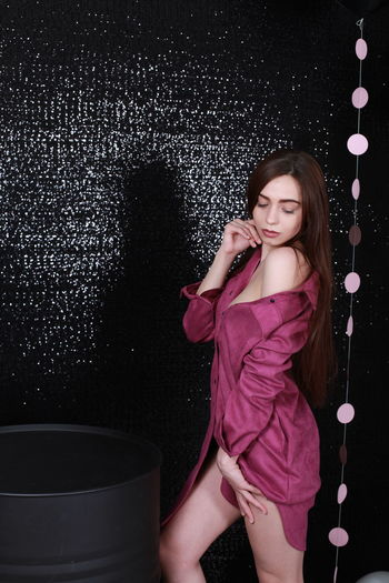Sexygirl Sensual_woman Pink Color Pink Dress Black Background Balloons Decoration One Person Young Adult Three Quarter Length Long Hair Standing Hairstyle Hair Fashion Women Front View Indoors  Beautiful Woman Beauty Casual Clothing Clothing Leisure Activity Looking At Camera Dress